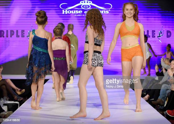 Models walk the runway for Triple D on day 2 of the House of iKons show during London Fashion Week September 2018 at the Millennium Gloucester London...