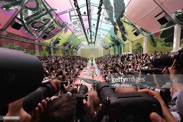 Models walk the runway in front of photographers at the Burberry Prorsum Ready to Wear show during London Fashion Week Spring Summer 2015 on...