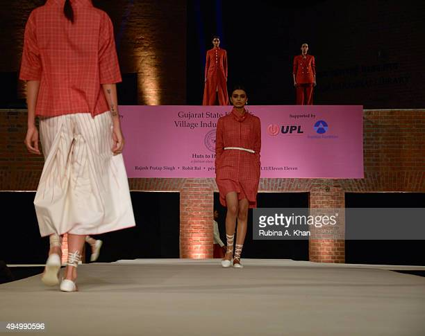 Models walk the runway in khadi designerwear at the Fashion Design Council of India's Huts to High Street a fashion show organised to promote khadi...