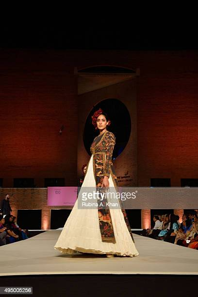 Models walk the runway in khadi designerwear by Rohit Bal at the Fashion Design Council of India's Huts to High Street a fashion show organised to...