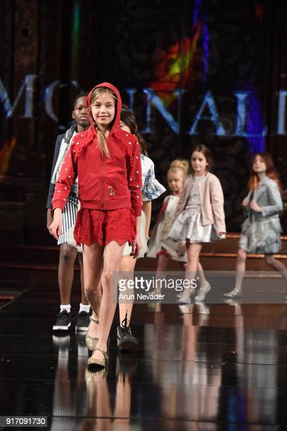 Models walk the runway in the Monnalisa presentation at New York Fashion Week Powered by Art Hearts Fashion NYFW at The Angel Orensanz Foundation on...