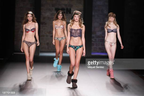 Models walk the runway in the TCN fashion show during the 080 BCN Fashion Week Fall/Winter 20122013 on January 25 2012 in Barcelona Spain