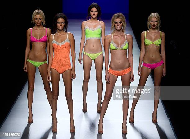 Models walk the runway in the TCN fashion show during the MercedesBenz Fashion Week Madrid Spring/Summer 2013 at Ifema on September 3 2012 in Madrid...