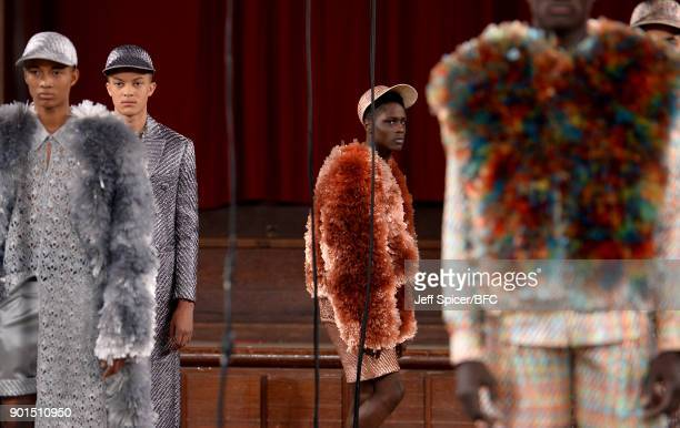 Models walk the runway wearing a design by Xu Bo at the LCFMA18 Menswear show during London Fashion Week Men's January 2018 at St John's Smith Square...