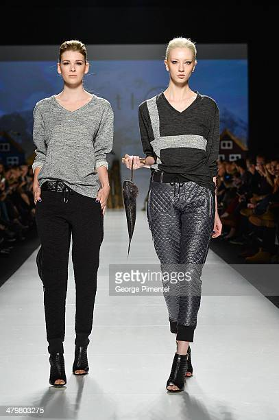 Models walk the runway wearing Bustle fall 2014 collection during World MasterCard Fashion Week Fall 2014 at David Pecaut Square on March 20 2014 in...