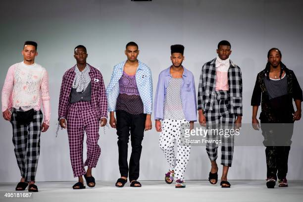Models walk the runway wearing designs by Anna De Souza during the Northbrook College show during day 2 of Graduate Fashion Week 2014 at The Old...