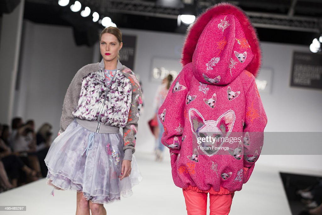 Models walk the runway wearing designs by Camilla Grimes during the Best of Graduate Fashion Week show during day 4 of Graduate Fashion Week 2014 at The Old Truman Brewery on June 3, 2014 in London, England.