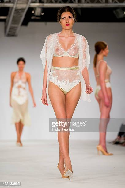 Models walk the runway wearing designs by Charlie Watson during the De Montfort Contour show during day 2 of Graduate Fashion Week 2014 at The Old...
