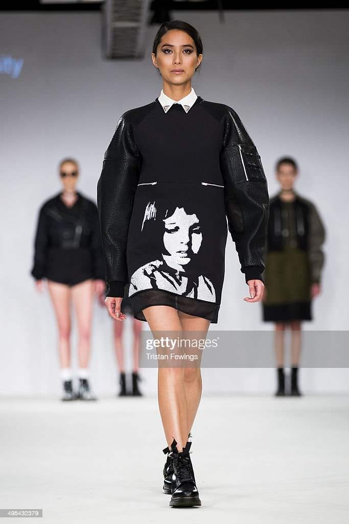 Models walk the runway wearing designs by Min Seo Park from Bunka Fashion Graduate University during the International Catwalk Competition show during day 4 of Graduate Fashion Week 2014 at The Old Truman Brewery on June 3, 2014 in London, England.