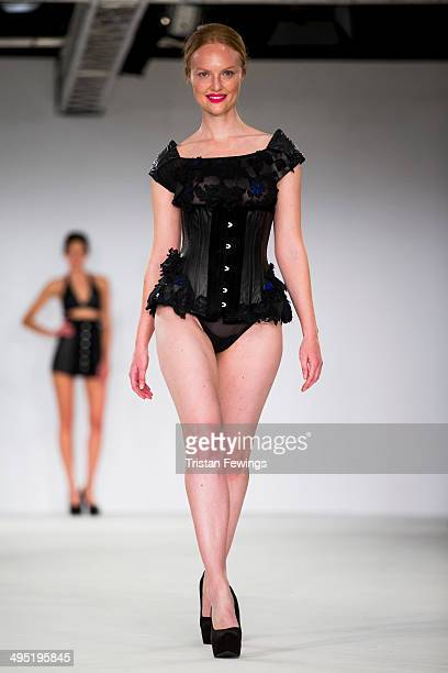 Models walk the runway wearing designs by Sammy Jo Witton during the De Montfort Contour show during day 2 of Graduate Fashion Week 2014 at The Old...