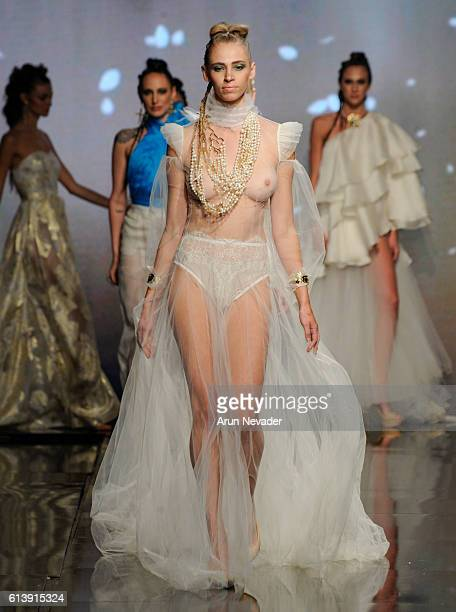 Models walk the runway wearing Fernando Alberto Atelier at Art Hearts Fashion Los Angeles Fashion Week presented by AIDS Healthcare Foundation on...