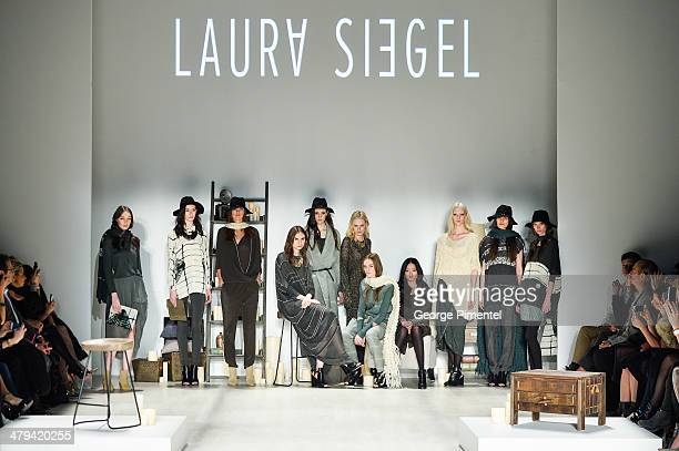 Models walk the runway wearing Laura Siegel fall 2014 collection during World MasterCard Fashion Week Fall 2014 at David Pecaut Square on March 18...