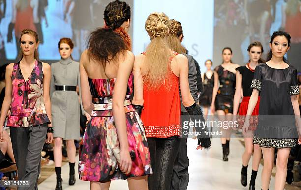 Models walk the runway wearing LOVAS fall 2010 collection at the Allstream Centre on March 30 2010 in Toronto Canada