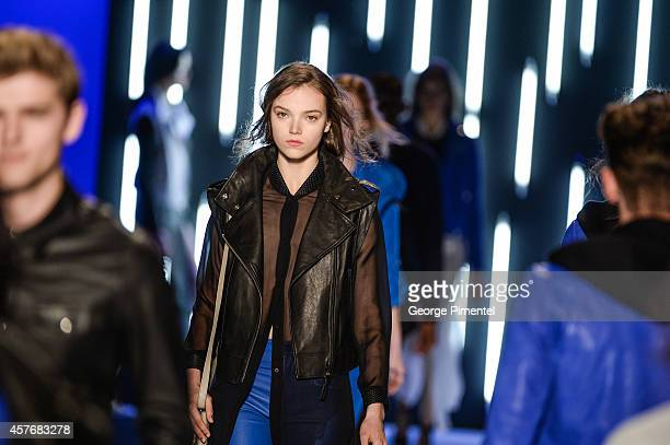 Models walk the runway wearing Mackage spring 2015 collection during World MasterCard Fashion Week Spring 2015 at David Pecaut Square on October 22...