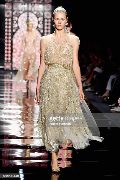 Models walk the runway wearing Reem Acra Spring 2016 during New York Fashion Week The Shows at The Dock Skylight at Moynihan Station on September 14...
