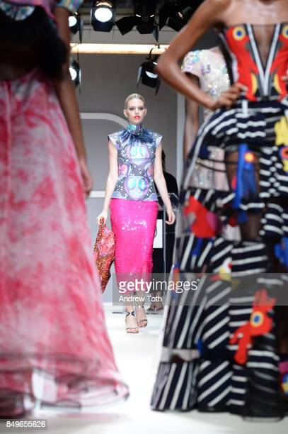Models walk the runway wearing selected African fashion designers during Fashion 4 Development's 7th Annual First Ladies Luncheon at The Pierre Hotel...
