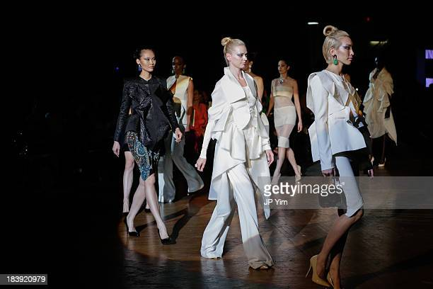 Models walk the runway wearing Sukeina during the 3rd Annual United Colors Of Fashion Gala at Lexington Avenue Armory on October 9 2013 in New York...