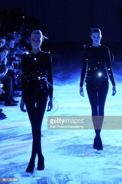Models walk the runway wearing the Hussein Chalayan Fall/Winter 2008/2009 collection during Paris Fashion Week on the 26th of February 2008 in...