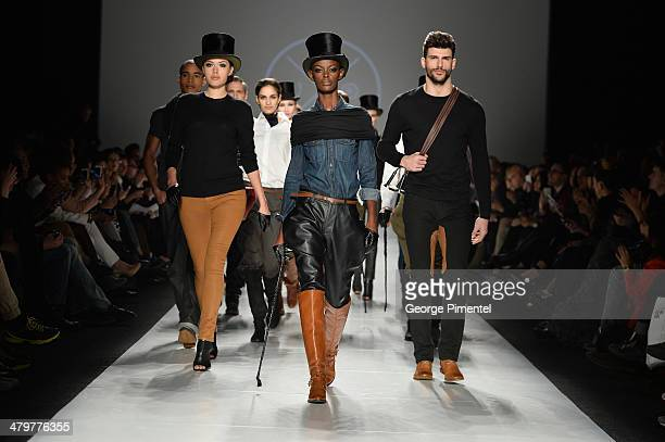 Models walk the runway wearing Triarchy fall 2014 collection during World MasterCard Fashion Week Fall 2014at David Pecaut Square on March 20 2014 in...