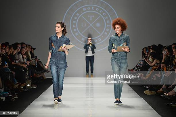 Models walk the runway wearing Triarchy fall 2015 collection during World MasterCard Fashion Week Fall 2015 at David Pecaut Square on March 25 2015...
