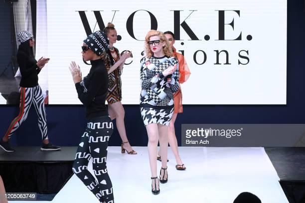 Models walk the runway wearing WOKE Creations during NYFW Powered By hiTechMODA on February 08, 2020 in New York City.