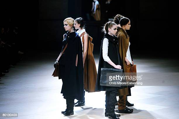 Models walk the runway wearing Yohji Yamamoto at the Fall/Winter 2008/2009 collection during Paris Fashion Week February 25, 2008 in Paris,France.