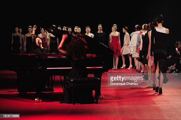Models walk the runway while pianist sisters Katia Labeque and Marielle Labeque perform during Nina Ricci Fall/Winter 2013 ReadytoWear show as part...