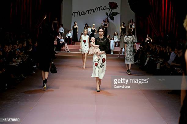 Models walk the runway with babies and children at the Dolce Gabbana Autumn Winter 2015 fashion show during Milan Fashion Week on March 1 2015 in...
