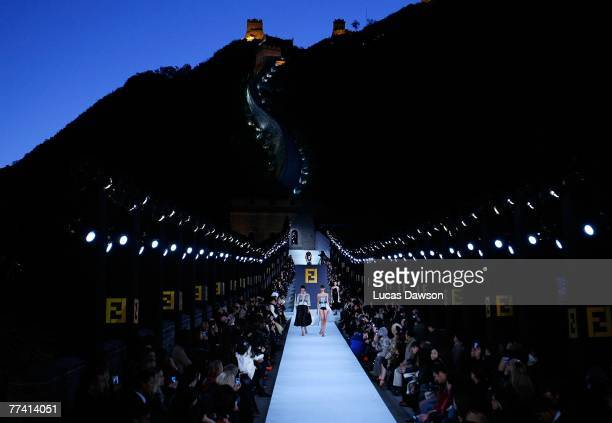 BEIJING OCTOBER 19 Models walk the runway with designer Karl Lagerfeld's Fall/Winter 2007 collection at the Fendi Great Wall of China fashion show...