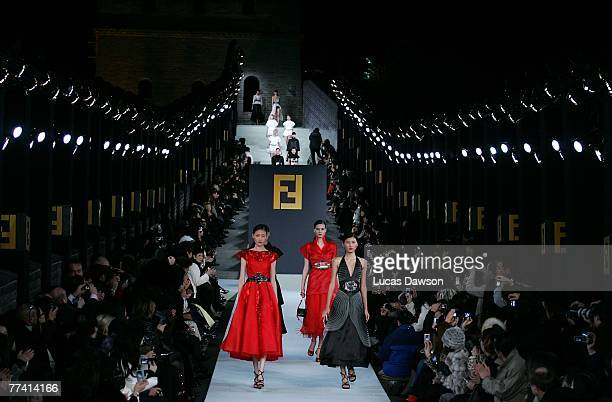 Models walk the runway with designer Karl Lagerfeld's Fall/Winter 2007 collection at the Fendi Great Wall of China fashion show taking place on the...
