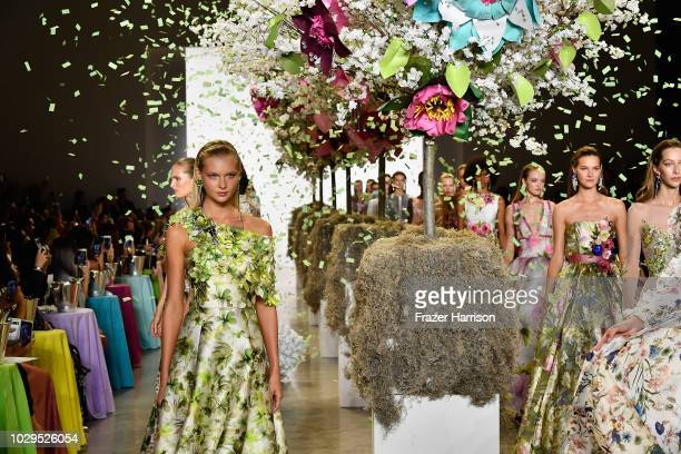 Models walk the runways at Badgley Mischka Runway during New York Fashion Week The Shows at Gallery I at Spring Studios on September 8 2018 in New...