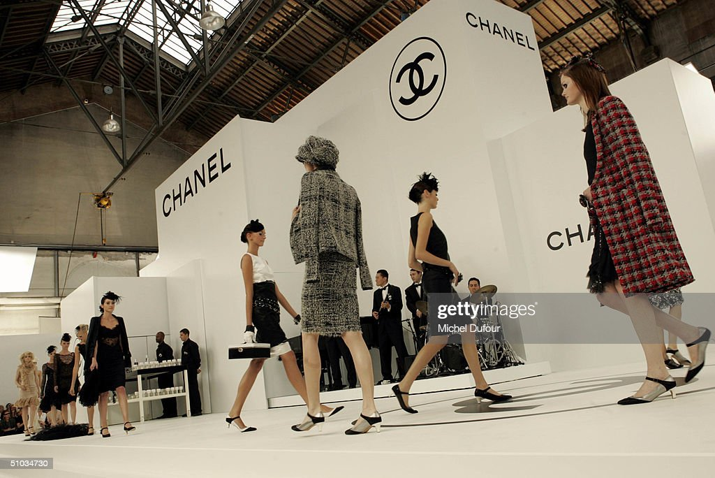 Models walk the stake at the Chanel Spring/Summer 2005 Fashion Show during Paris Fashion Week on July 7, 2004 in Paris, France.