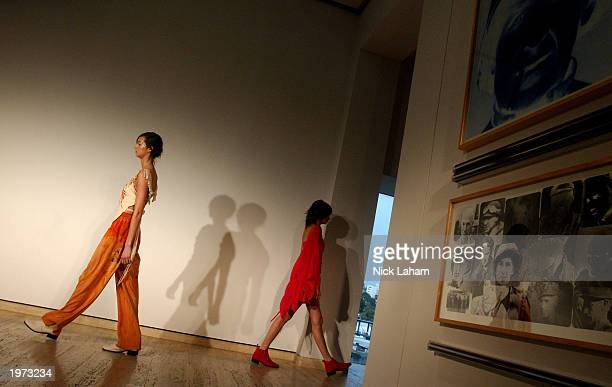 Models walk through the gallery at the Akira Spring/Summer 2003 Collection fashion show at the Art Gallery of New South Wales May 5 2003 during the...