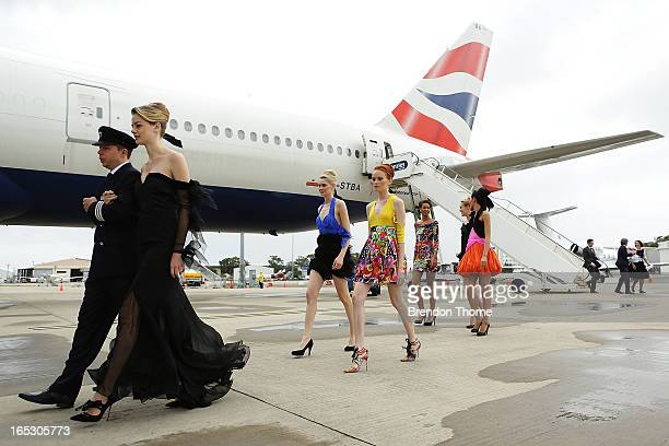 Models walk with British Airways pilots on April 3 2013 in Sydney Australia Celebrating a new chapter in British Airways long history of flying...