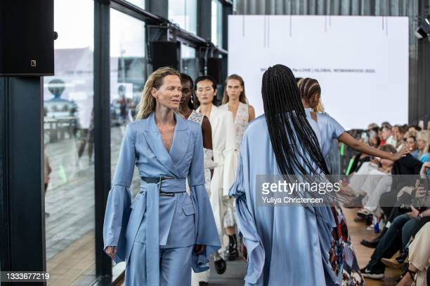 Models walking final walk on the runway at the Teatum Jones show during the Copenhagen Fashion Week Spring/Summer 2022 on August 11, 2021 in...
