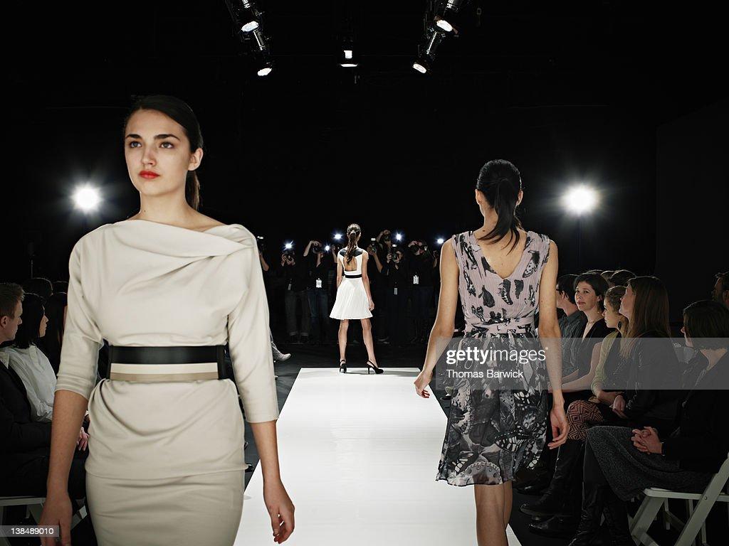 Models walking on runway during fashion show : Stock Photo