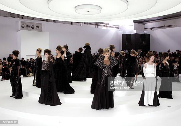Models walks down the runaway at the Chanel AutumnWinter 200506 Collection fashion show designed by Karl Lagerfeld on July 7 2005 in Paris France
