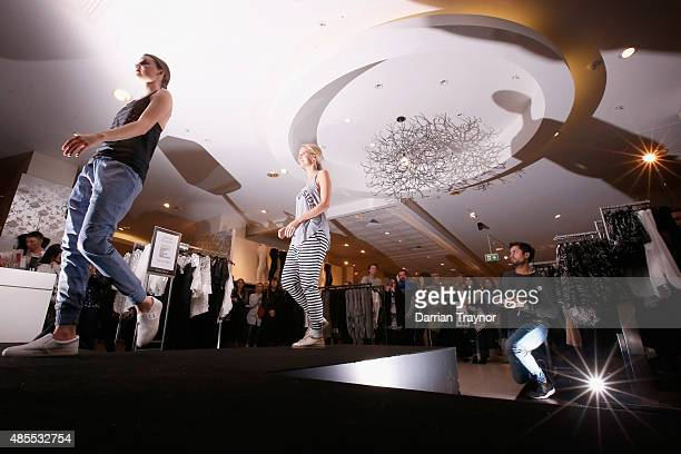 Models walks the run way in a fashion show inside David Jones during Vogue Fashion's Night Out on August 28 2015 in Melbourne Australia
