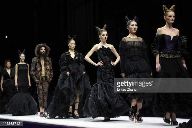 Models walks the runway at the MRHUA MRSHUA collection show by Chinese designer NiuNiu Chou during the China Fashion Week A/W 2019/2020 on March 30,...