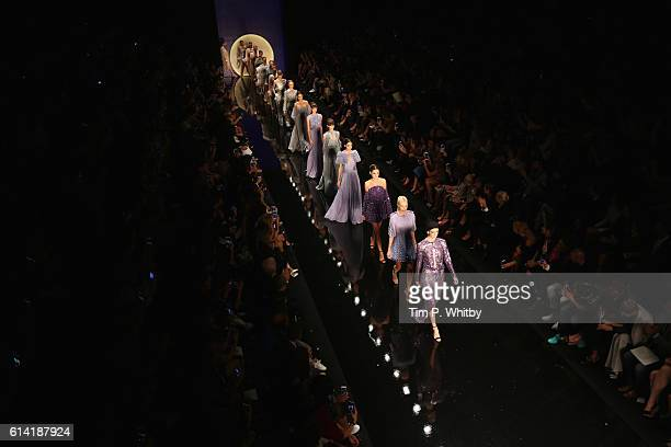 Models walks the runway at the Ozgur Masur show during MercedesBenz Fashion Week Istanbul at Zorlu Center on October 12 2016 in Istanbul Turkey