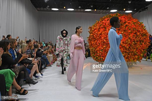 Models walks the runway at the Richard Quinn show during London Fashion Week September 2021 on September 21, 2021 in London, England.