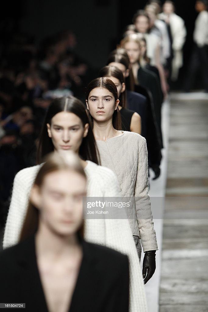 Models walks the runway at the Theyskens' Theory fall 2013 fashion show during Mercedes-Benz Fashion Week at Skylight at Moynihan Station on February 11, 2013 in New York City.