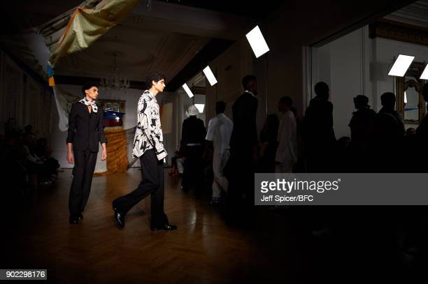 Models walks the runway at the WALES BONNER show during London Fashion Week Men's January 2018 at One Belgravia on January 7 2018 in London England
