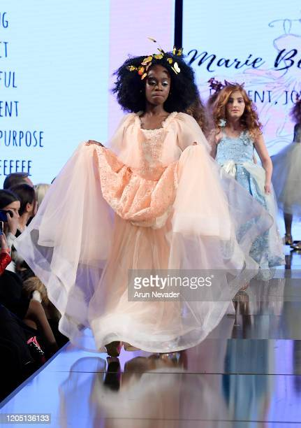 Models walks the runway during Marie Belle Couture At New York Fashion Week Powered By Art Hearts Fashion NYFW 2020 at The Angel Orensanz Foundation...