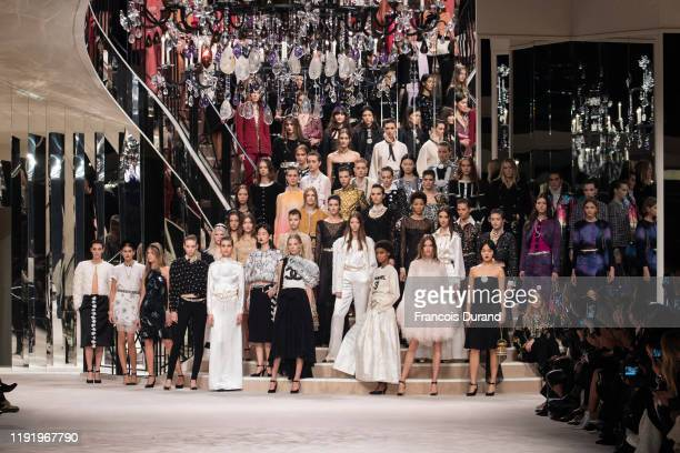 Models walks the runway during the Chanel Metiers d'art 2019-2020 show at Le Grand Palais on December 04, 2019 in Paris, France.