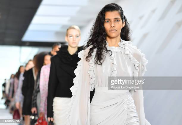 Models walks the runway during the Giambattista Valli show as part of the Paris Fashion Week Womenswear Fall/Winter 2019/2020 on March 04 2019 in...