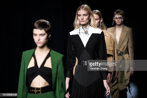 Models walks the runway during the Givenchy show as part of the Paris Fashion Week Womenswear Spring/Summer 2019 on September 30 2018 in Paris France