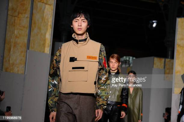 Models walks the runway during the Heron Preston Menswear Fall/Winter 2020-2021 show as part of Paris Fashion Week At le Carreau Du Temple on January...
