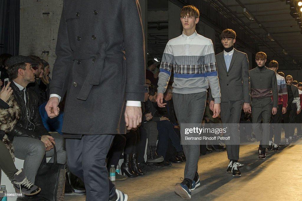 Models walks the runway during the Krisvanassche Men Autumn / Winter 2013 show as part of Paris Fashion Week on January 18, 2013 in Paris, France.