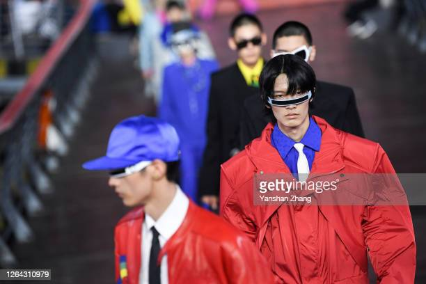 Models walks the runway during the Louis Vuitton S/S21 Men's Collection show at Shanghai Tank Art Park on August 6, 2020 in Shanghai, China.